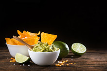 Bowl With Guacamole Sauce And Nachos Chips
