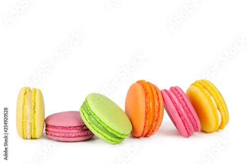 Poster Macarons Colorful french macaroons in row isolated on white