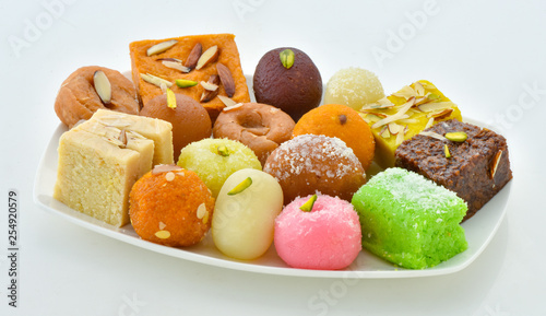 Obraz na plátne Mix Sweets in Dish, A large variety of Pakistani Mithai