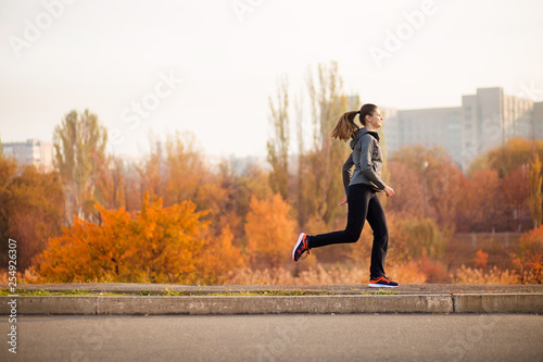 Poster Glisse hiver Woman running in autumn fall forest. Healthy concept