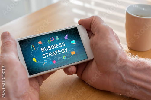 Stickers pour porte Pierre, Sable Business strategy concept on a smartphone