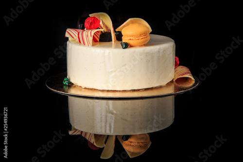 Fotografie, Obraz  delicious round cake with white glaze and ellow macaron