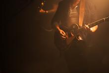 Guitarist On A Dark Stage