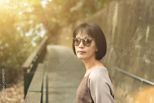 Fotografie, Obraz  Asian woman hiking