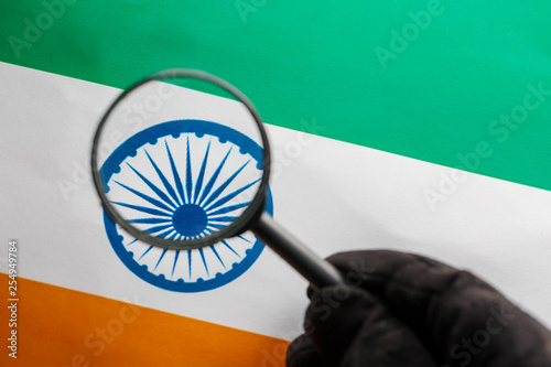 Photo  The Indian flag is visible through a magnifying glass