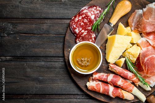 Antipasto background.Board with traditional Italian snacks. Fototapeta