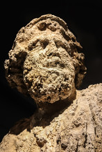 Really Eroded Head Of Poseidon - God Of The Sea Earthquakes Storms, And Horses - That Was Underwater For A Long Time And Is Pitted And Worn