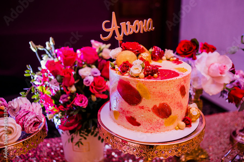 Sweet cake decorated of candies and roses with the inscription Alena Canvas Print