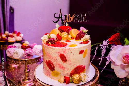Fine cake decorated of candies and roses with the inscription Alena Canvas Print
