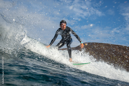 Recess Fitting Water Motor sports surfer riding waves on the island of fuerteventura in the Atlantic Ocean