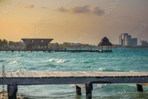 Valokuva  Pier on a beautiful sunset sun, with an azure sea