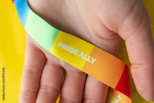 Fotografía  LGBT symbol - hand with rainbow ribbon and pride ally, the concept of support of