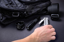 Everyday Carry (EDC) Items For Men In Black Color - Backpack, Tactical Belt, Flashlight,  Watch And Silver Multi Tool.