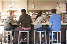 Multiethnic Group Of People Friends Couples Dining Out Together In Casual Restaurant Cafe