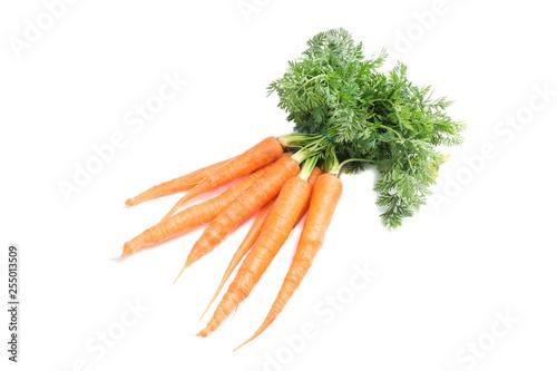 Fotografía  Ripe fresh carrots isolated on white background