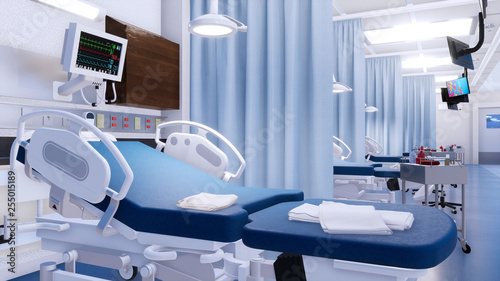 Close-up of empty hospital bed and various first aid medical equipment in emergency room of modern clinic Canvas Print