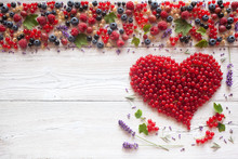 Red Currant Heart And Other Berries On Wooden Background
