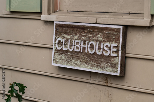Fotografie, Obraz  Wooden Clubhouse sign mounted on the outside of apartment building