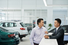 Customer At Car Dealership