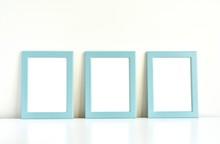 Three Blank Photo Frames On Wh...