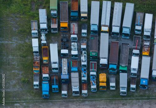 Deurstickers Surrealisme Trucks Parking. Aerial view from height.