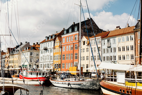Row of traditional, colorful Danish buildings along the canal in Nyhavn Canvas Print