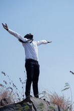 Freedom African Businessman Standing On Top Of Mountain