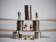 canvas print picture - The concept of pyramid of social class. Miniature people and piles of coins.
