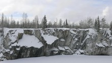 Young Woman Taking A Picture Of A Marble Quarry On The Phone In Winter