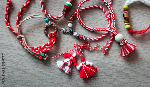 Fotografie, Obraz  Bulgarian traditional spring decor martenitsa bracelets, wooden background
