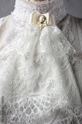 Fragment of a Victorian dress with a brooch. Poster Mural XXL