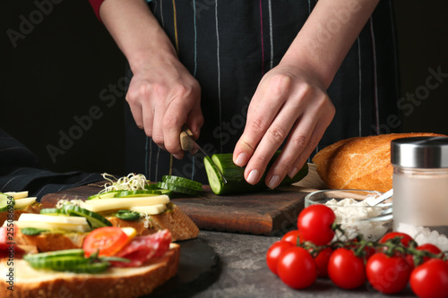 Poster Cuisine Woman preparing tasty bruschettas