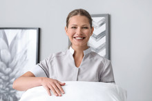 Beautiful Female Housekeeper With Soft Pillow In Room