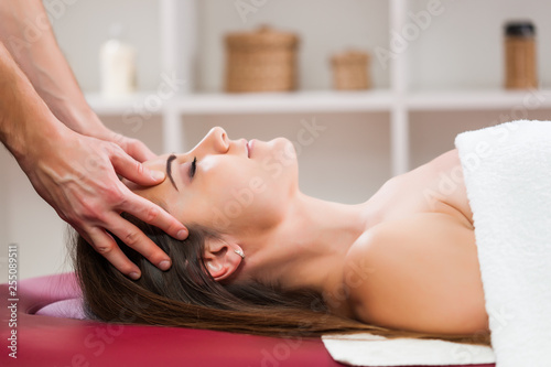 Poster Spa Young woman is enjoying massage on spa treatment.