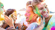 Leinwandbild Motiv Happy friends having fun at beach party on holi colors festival event - Young people laughing together with candid excited mood at summer vacation - Youth friendship concept on vivid contrasted filter