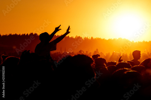 Girl cheering at outdoor music, rock festival - 255102350