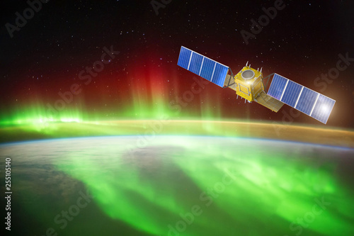 Fotografia, Obraz  Satellite for observing aurora borealis in Earth orbit, measuring the flow of sun particles, the solar wind