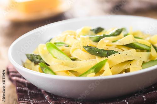 Fresh homemade pasta dish of fettuccine or tagliatelle, green asparagus, garlic Obraz na płótnie