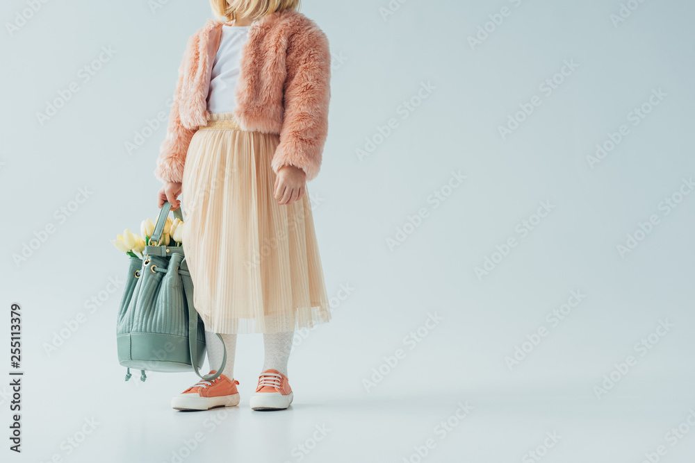 Fototapety, obrazy: cropped view of cute kid holding bag with white tulips on grey background