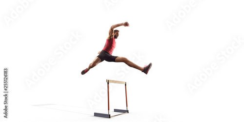 Vászonkép Isolated Male Track and field athlete jumps over the barrier on white background