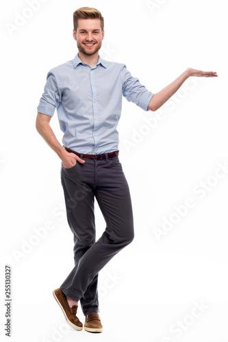 Fototapeta Full length portrait of young man standing on white background obraz