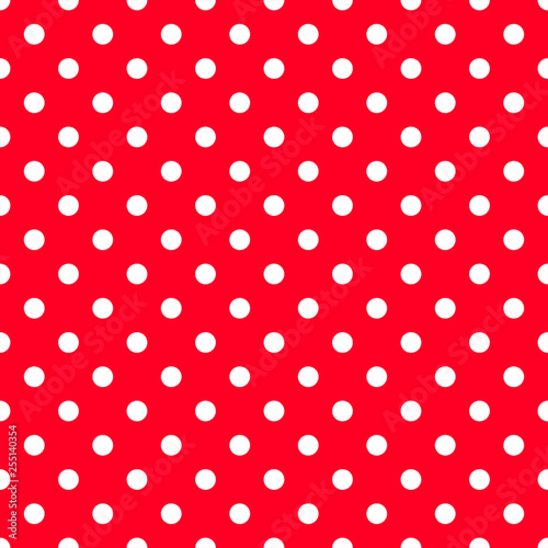 White polka dots on strawberry red background. Decorative seamless pattern