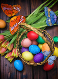 Fototapeta Tulipany - Easter background with tulips and painted eggs