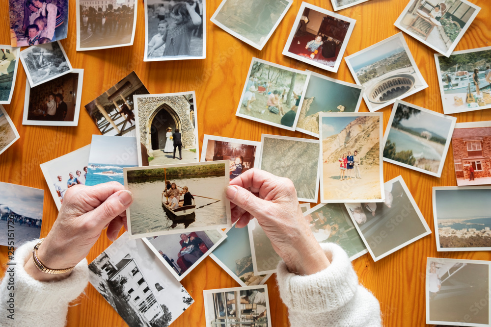Fototapety, obrazy: Top view of a senior caucasian woman looking at an old photos themes of memories nostalgia photos retired