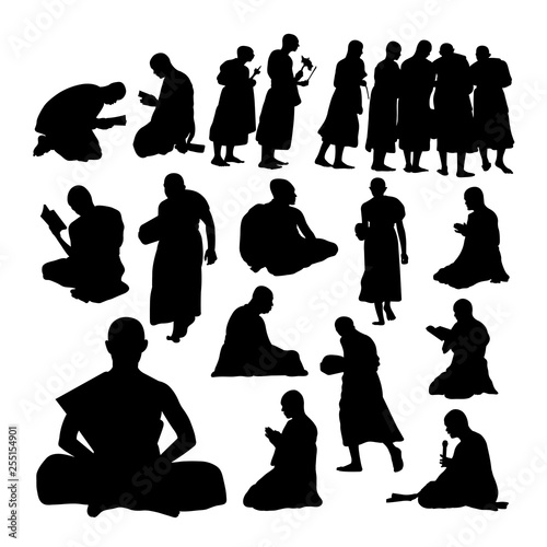 Photo Buddhist monk gesture silhouettes