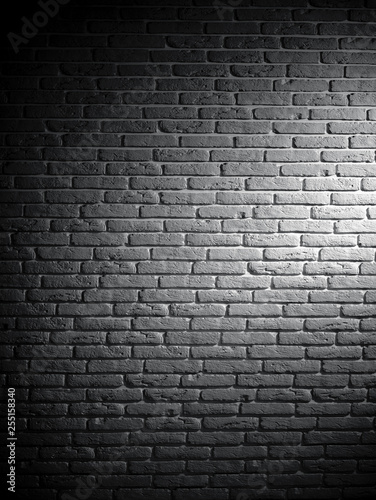 Foto op Plexiglas Background of black and white brick textured vintage wall with light pattern