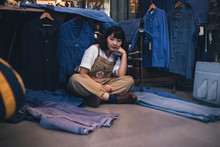 Portrait Of Beautiful Asian Woman Working At Vintage Clothes Shop.