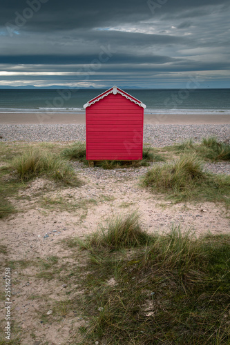 Red hut on the beach Canvas Print