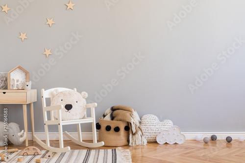 Fotografía  Stylish scandinavian newborn baby room with toys, teddy bear on children's chair, natural basket with blanket