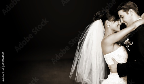 Fotografie, Obraz  Happy just married young couple on black background, vintage